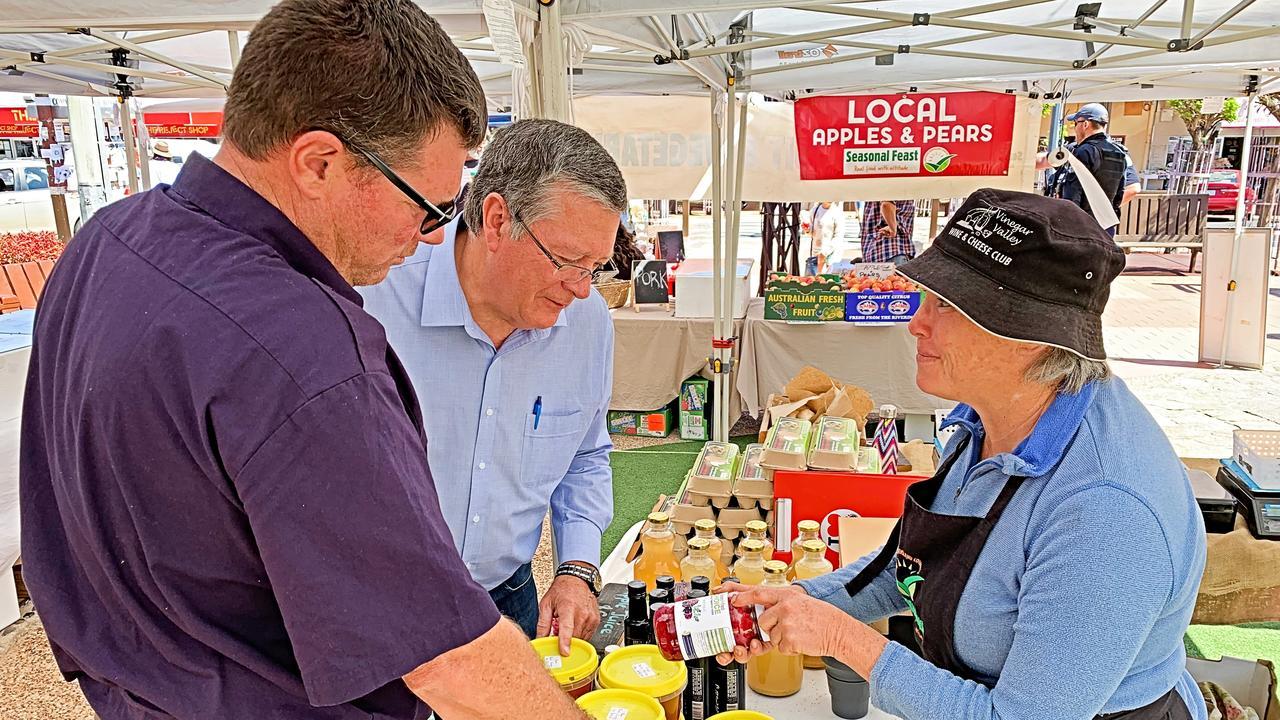 State Recovery Coordinator Ian Stewart and Cr Cameron Gow speak to Stanthorpe local and Seasonal Feast markets coordinator Bridget Ryan.