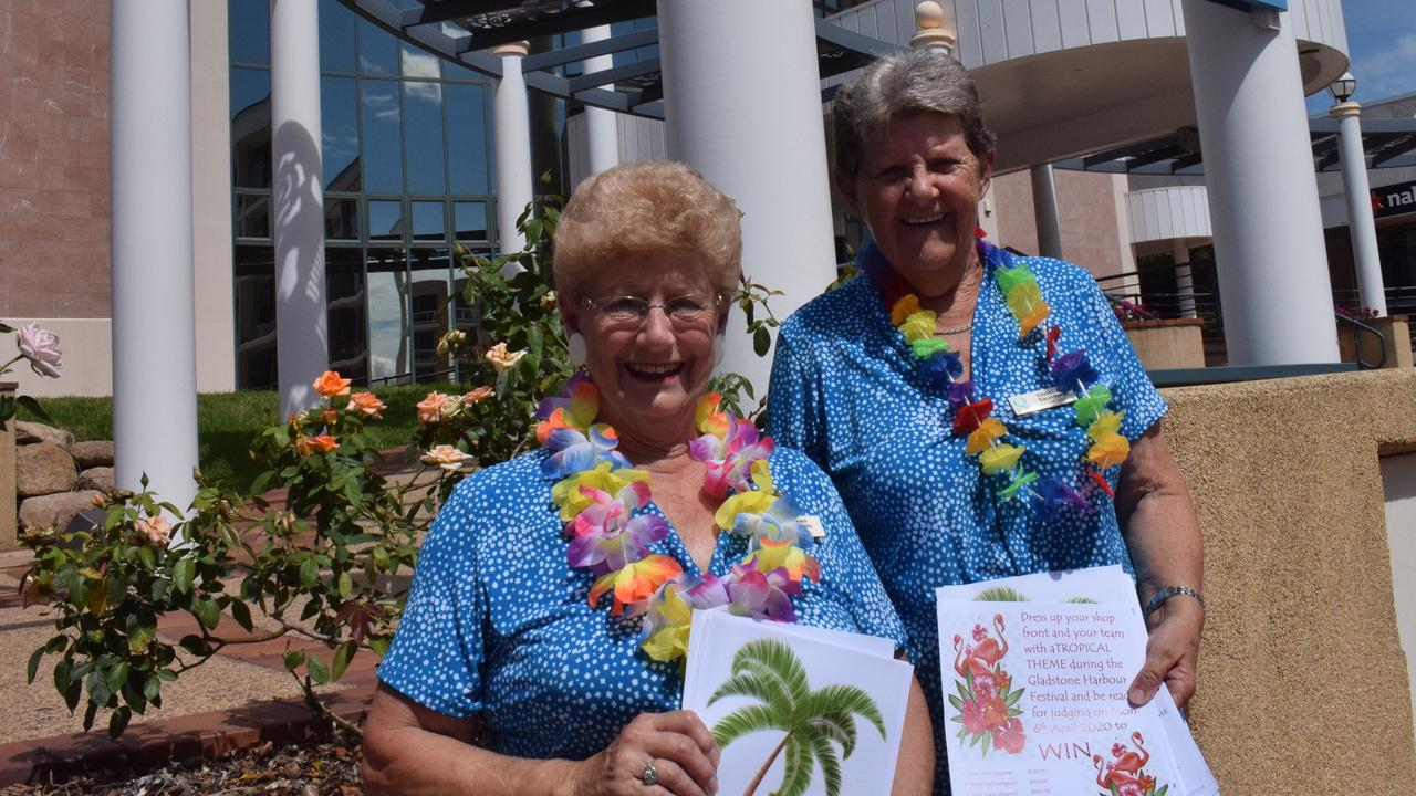 Quota Club secretary Aileen Weeden and president Christine Saunders with flyers for the Tropical Wednesday shop front competition.