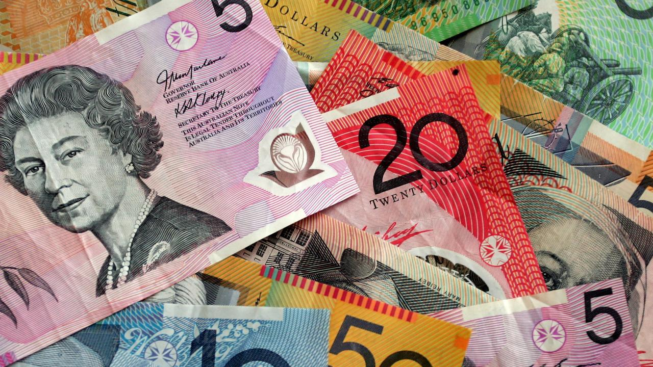 Police found more than $17,000 at Burt and Mihailou's Bargara home.