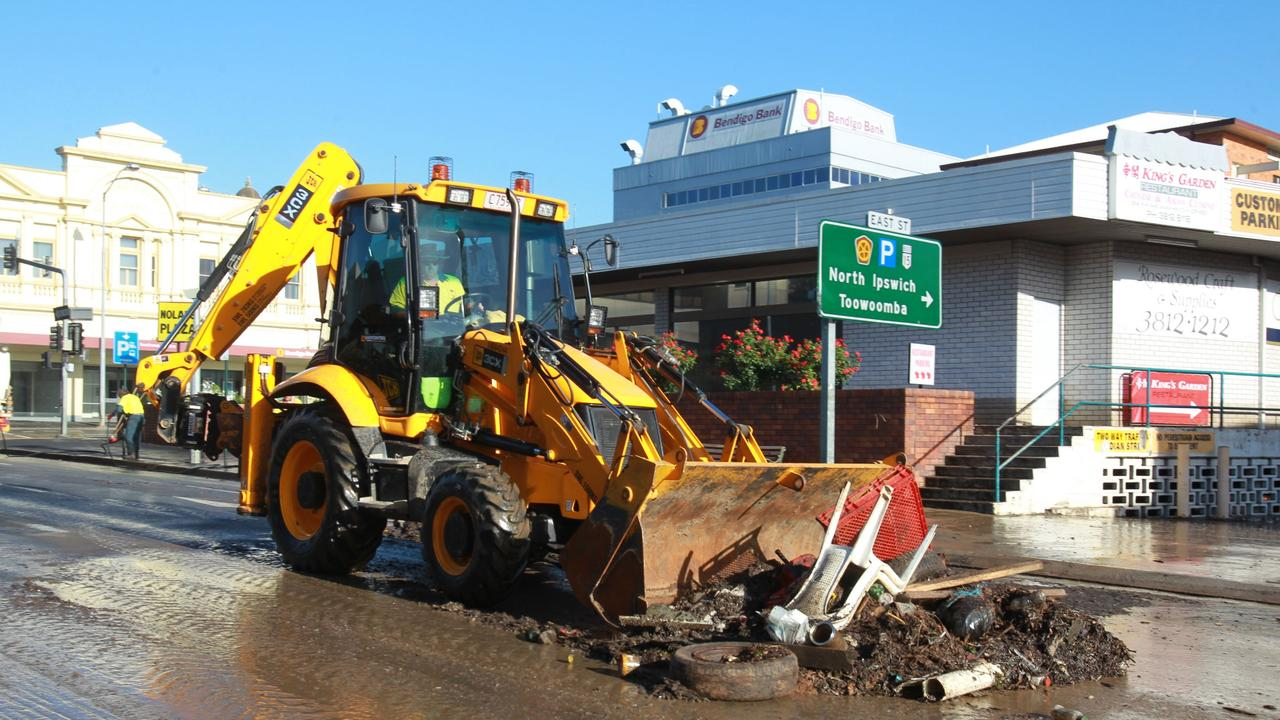 Clean up efforts in the lower CBD of Ipswich following 2011's floods. Pic :Adam Smith