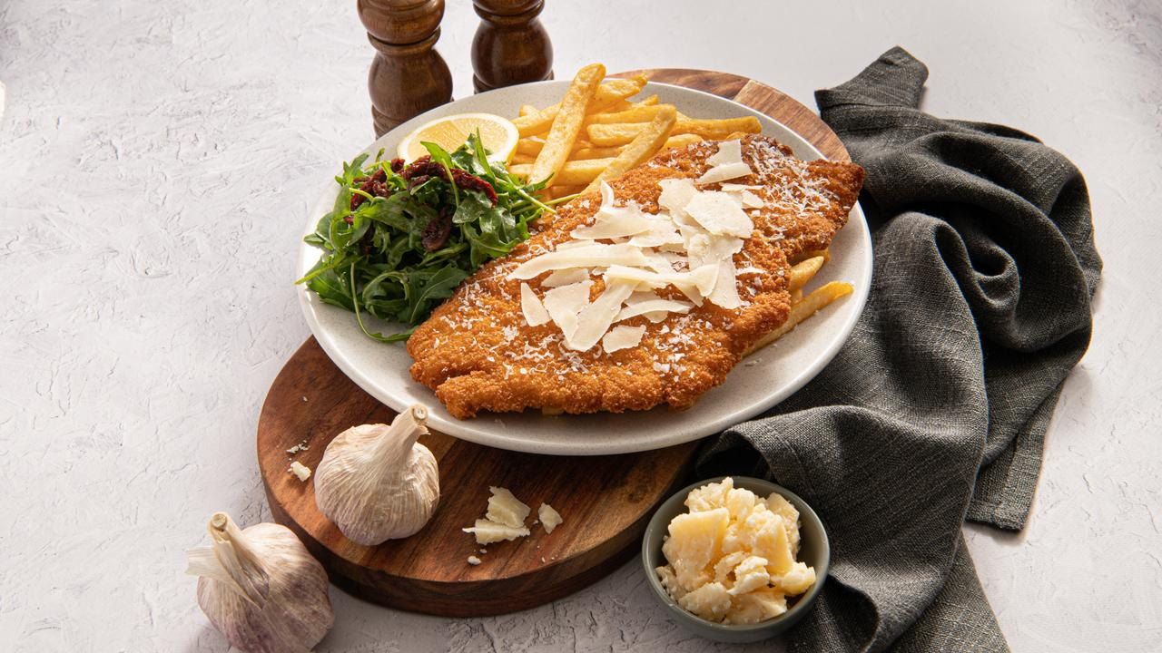The Bavarian schnitzel of the month is back and March is golden-crusted chicken breast with garlic and parmesan. Picture: Aidan De La Paz/Daily Press