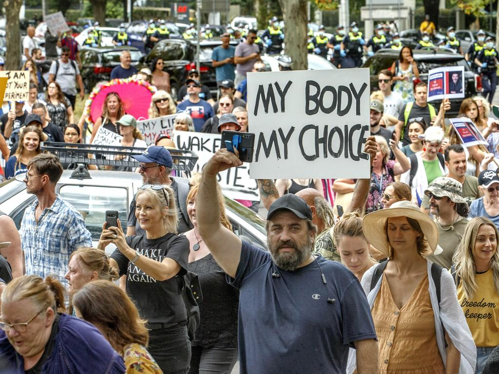 Protesters march in St Kilda Road. Picture: David Geraghty/NCA NewsWire