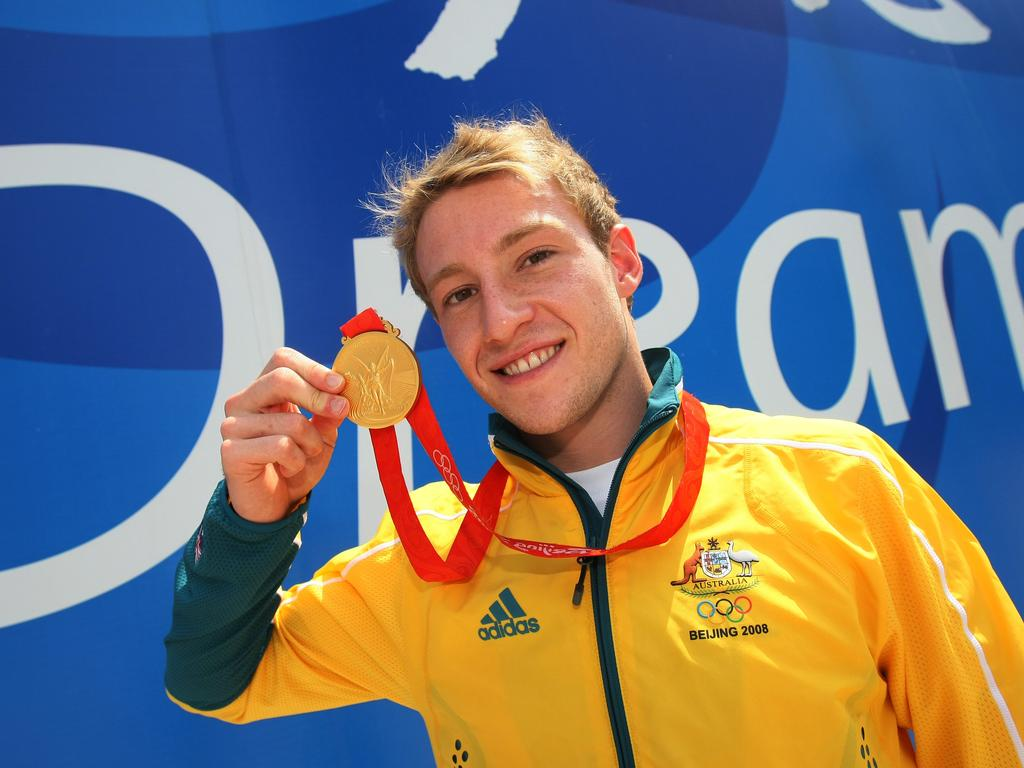 Matthew Mitcham parades his gold medal.