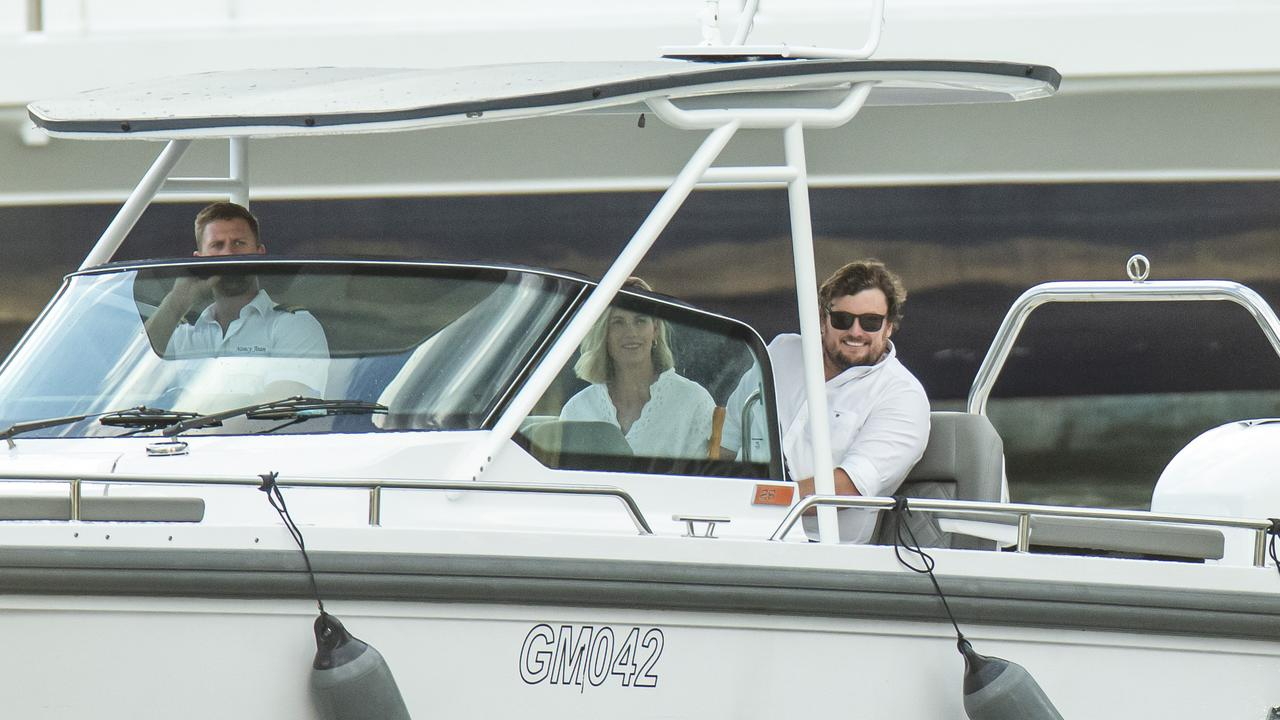 David Hutchinson travels by tender to Palmer's yacht on election night. Picture: Mark Cranitch.