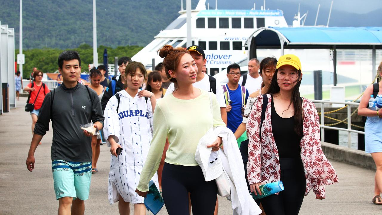 Chinese tourists leave the Cairns Marlin Marina after spending the day travelling on tourism boats to the Great Barrier Reef before the pandemic hit. Picture: Brendan Radke