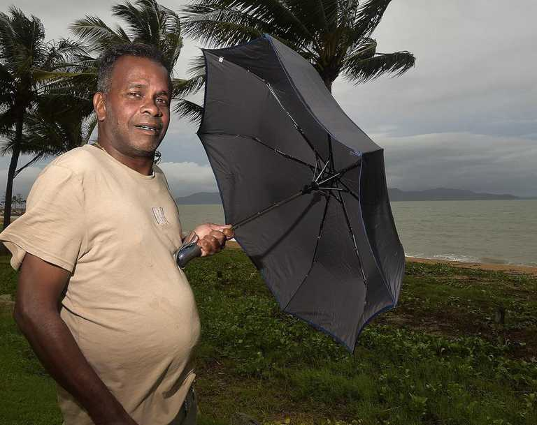 Jordan Rajadurai braves conditions on The Strand in January as Tropical Cyclone Kimi sits off the coast. PICTURE: MATT TAYLOR.