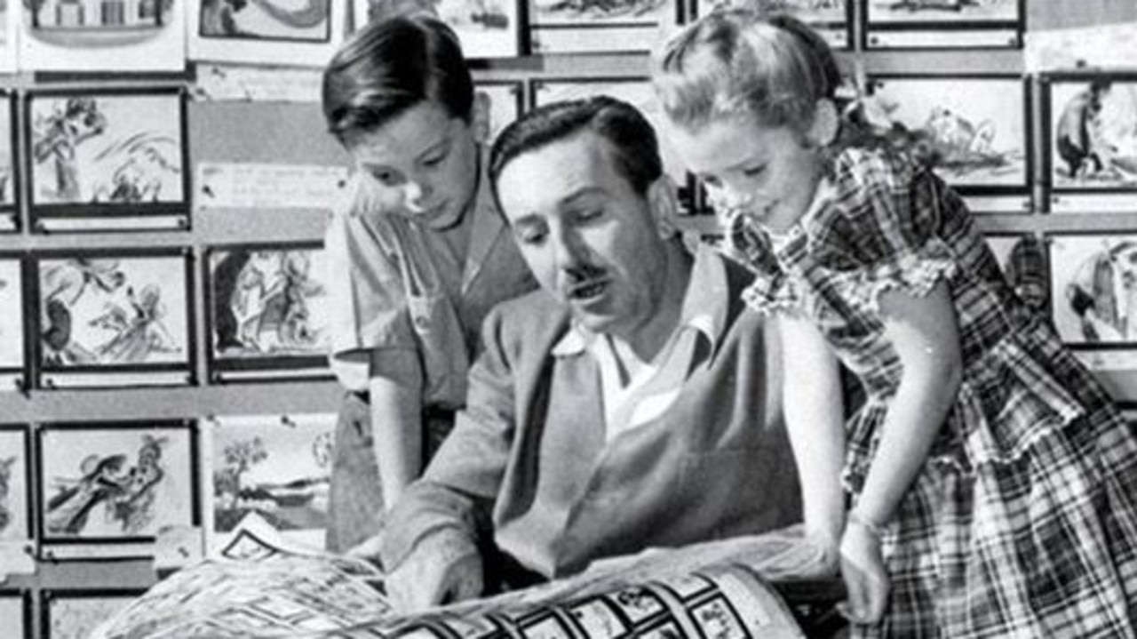 Walt Disney (centre) with Bobby Driscoll and Luana Patten in 1946.