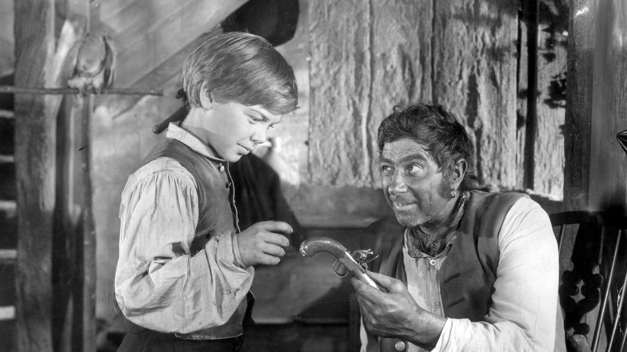 Bobby Driscoll and Robert Newton in Treasure Island.