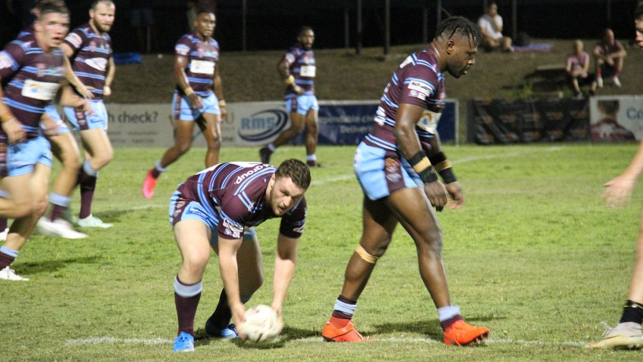 The CQ Capras' Jedidiah Simbiken plays the ball to Treymaine Brown. Picture: Rodney Stevens