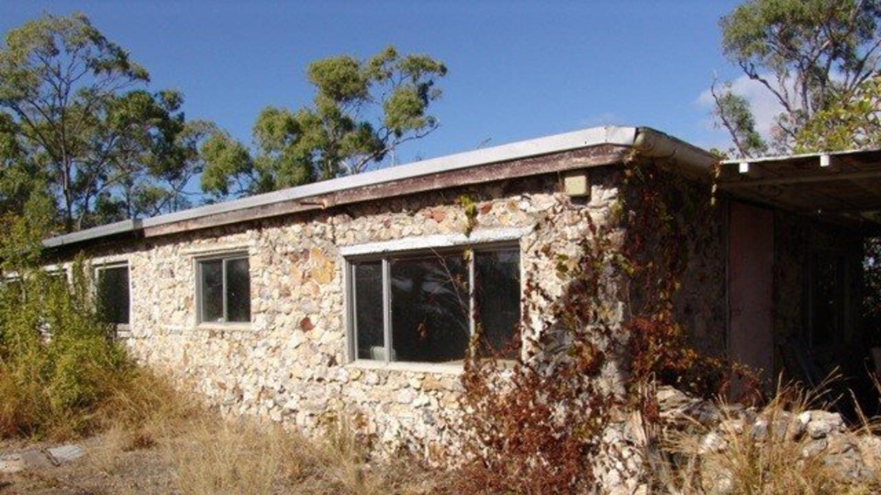 The lot features some stone houses that are in need of some work but are still recoverable.