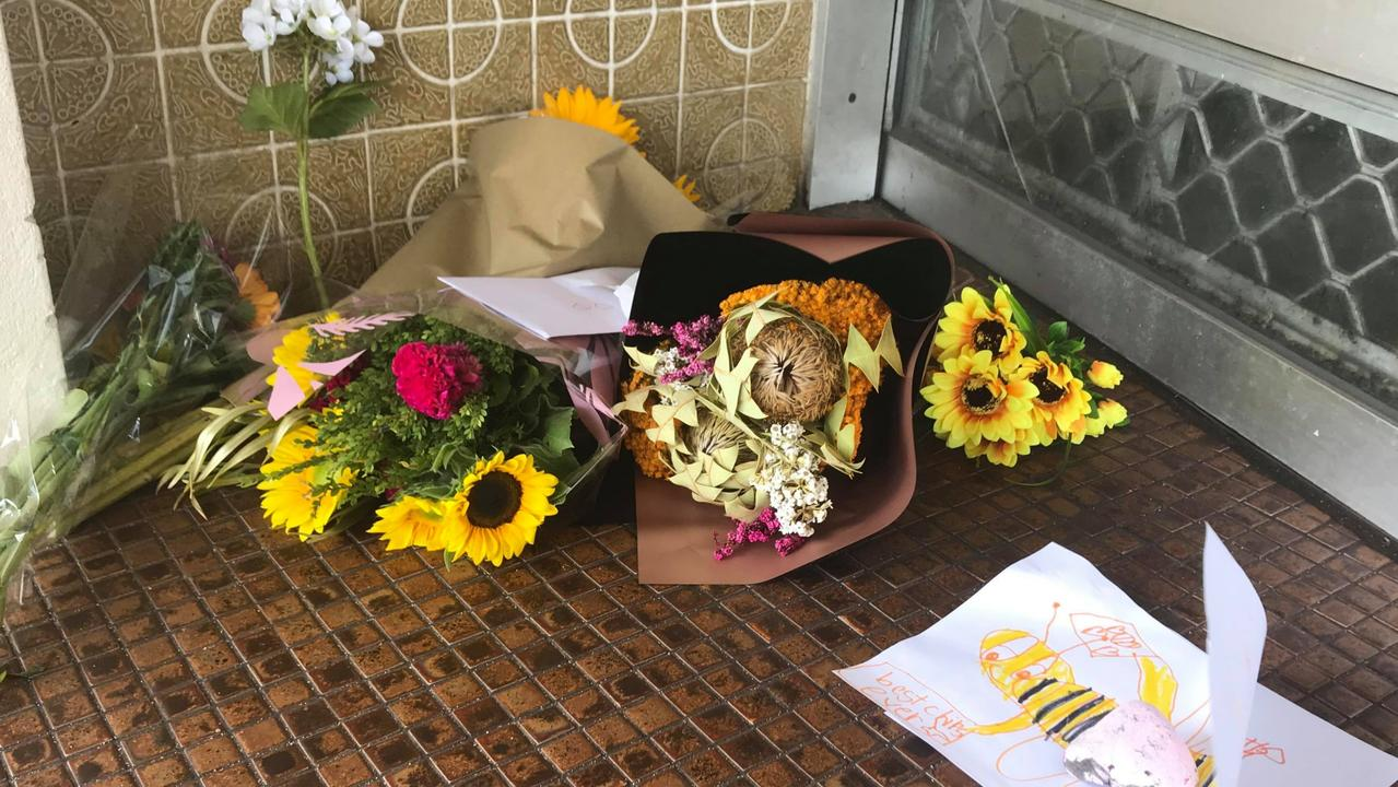 Flowers, cards and tributes have been left outside Busy Bee, which is currently closed for renovations.