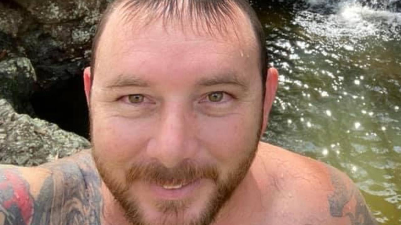Mackay father Aaron Thomas Harman trembled as he appeared in Mackay Magistrates Court for a brutal road rage attack over a water splash.