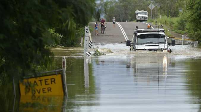 PHOTOS: Motorist tackles flooded bridge