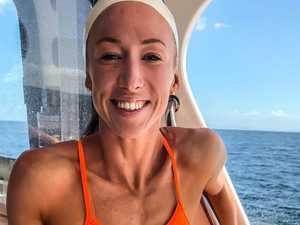 Heartbreaking loss drives momentous Bribie Island swim