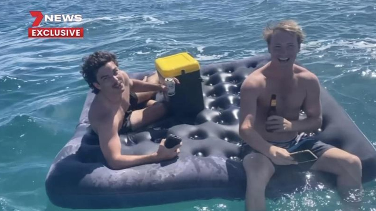 Jackson Perry and Noah Palmer, from Mandurah, took a mattress offshore. Picture: 7 News