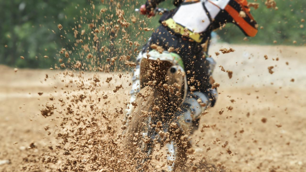 Mud debris flying from a motocross race