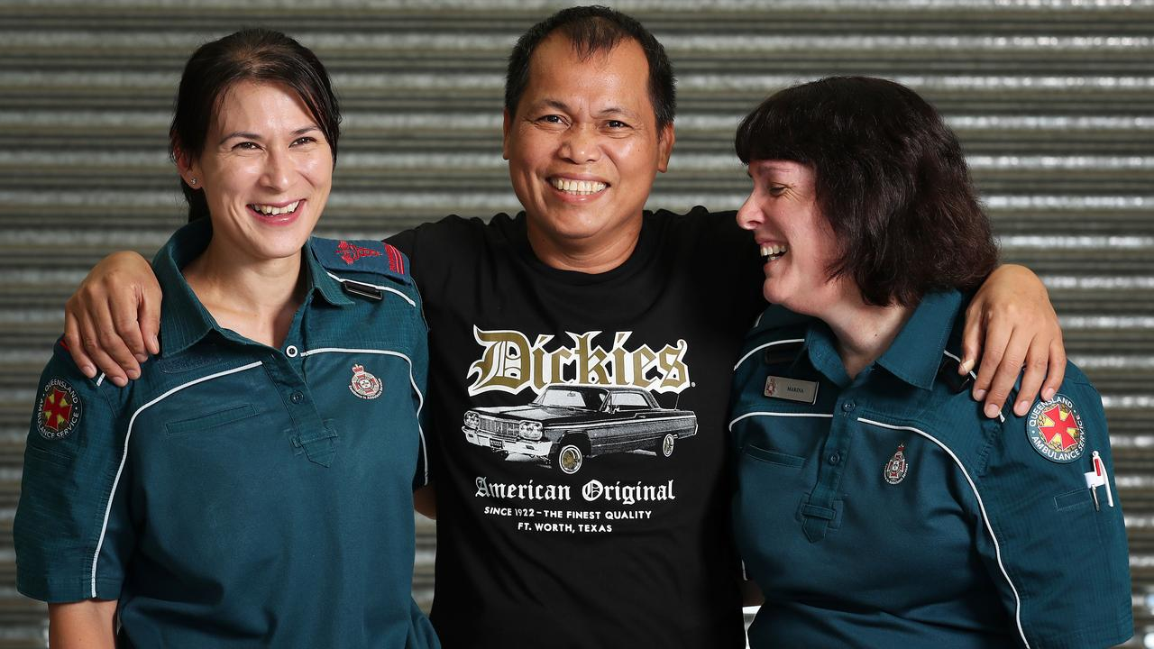 Jaime Estrella, 49 of Slacks Creek, reunited with QAS first responding crew that helped save his life – Sonia Wu and Marina Giannaros. Picture: Liam Kidston.
