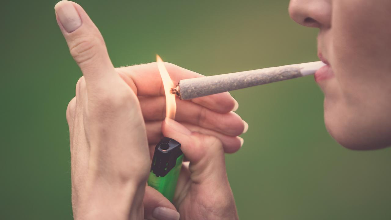 A woman smokes a cannabis joint - but what's really in it? FILE PHOTO.