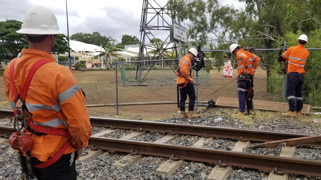 Queensland Rail workers at the Alexandra Railway Bridge.