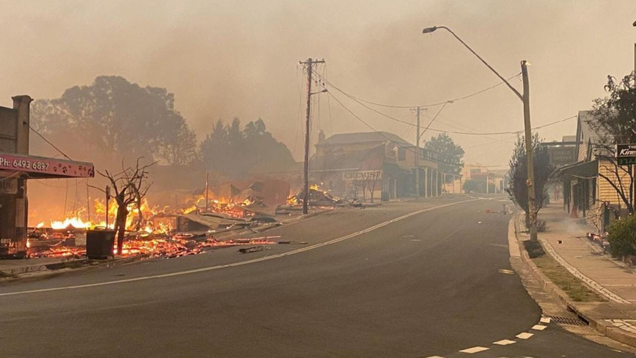A bushfire takes hold in the main street of Cobargo.