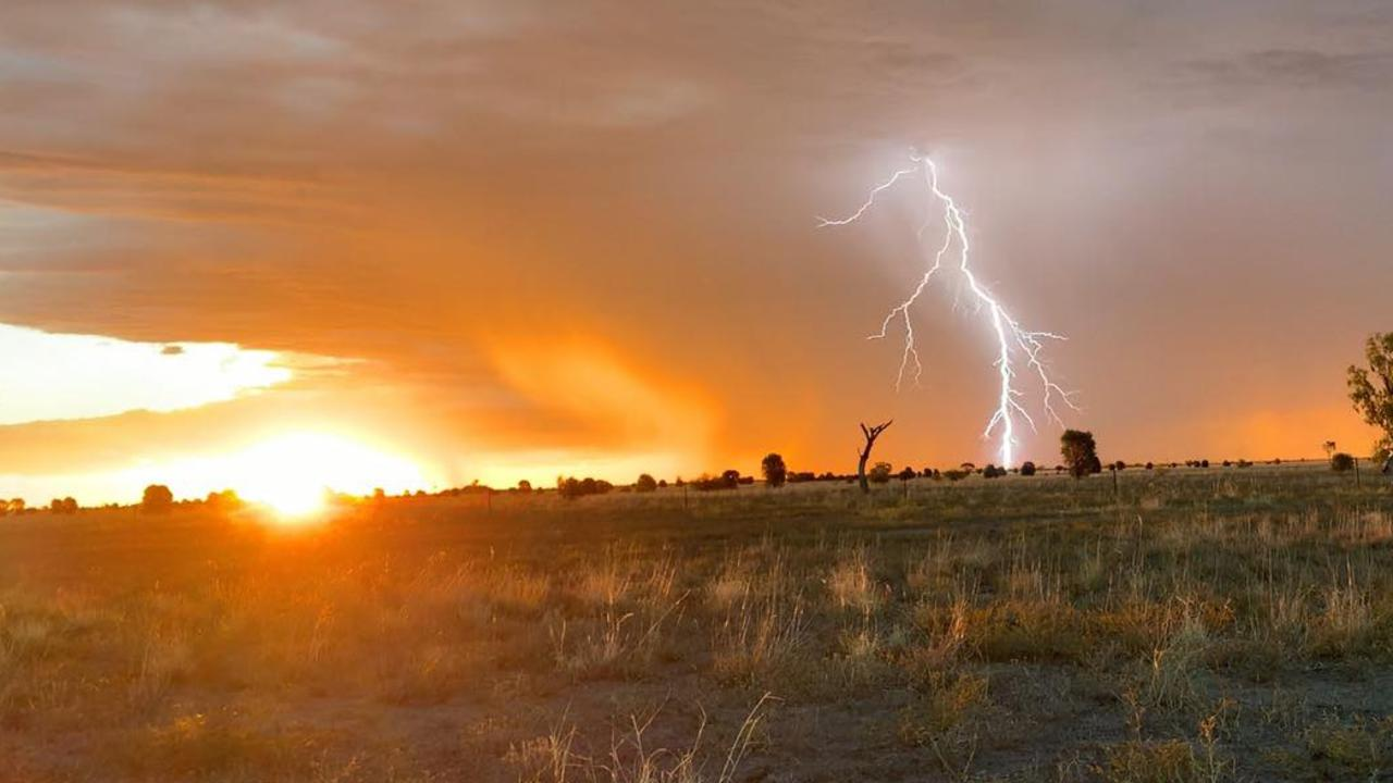 A bolt of lightning striking the ground in Blackall in the Central West. Photo: Kayla Carter