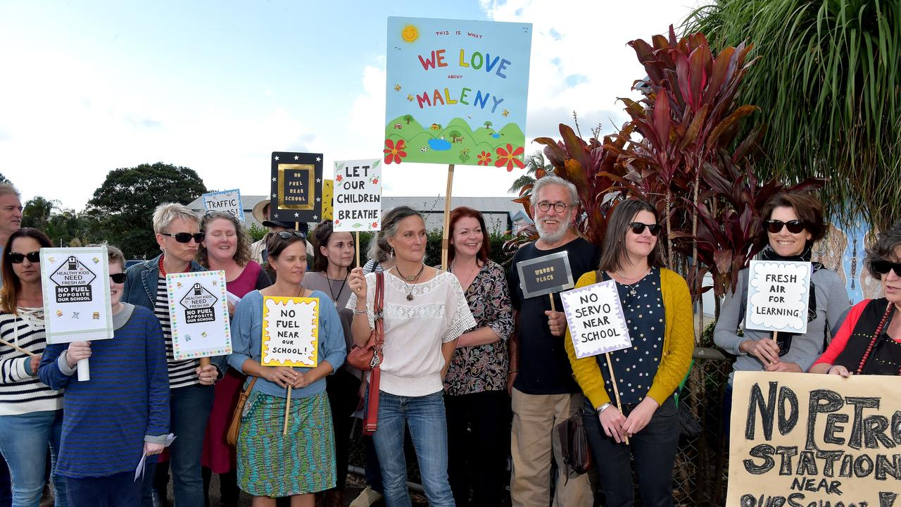 Members of the Maleny community gathered to protest the proposed service station opposite the local primary school.