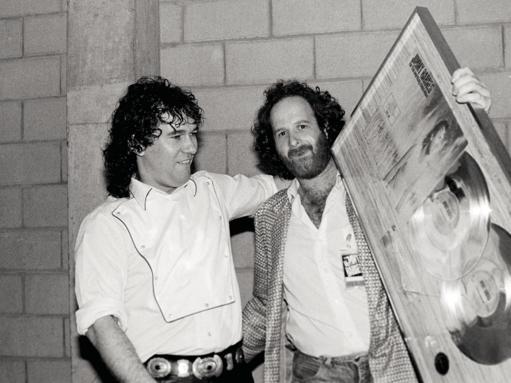 Jimmy Barnes and Michael Gudinski at the double-platinum record presentation for Working Class Man. Picture: Bob King
