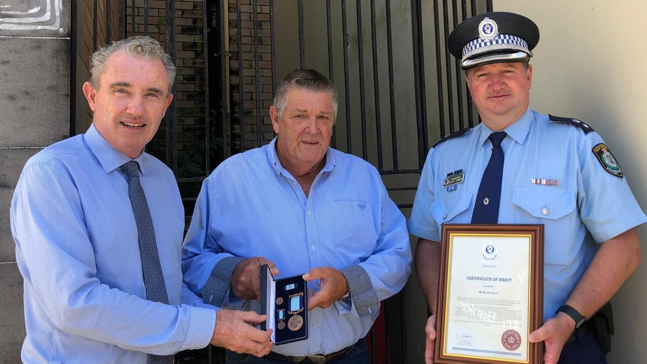 BRAVEHEART: Kevin Dowd's selfless act in rescuing a stranger man from his burning car shortly before it exploded was recognised with a Royal Humane Society of NSW Bronze Medal Bravery Award, presented by Federal Member for Page Kevin Hogan. Richmond Police District Commander Superintendent Scott Tanner also presented Mr Dowd with a commendation. Photo: Alison Paterson