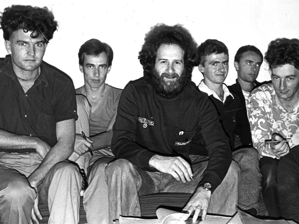 Michael Gudinski, centre, with Tim Finn (far left) and Neil Finn (third from right) of Split Enz in 1979. Picture: DAVID PARKER