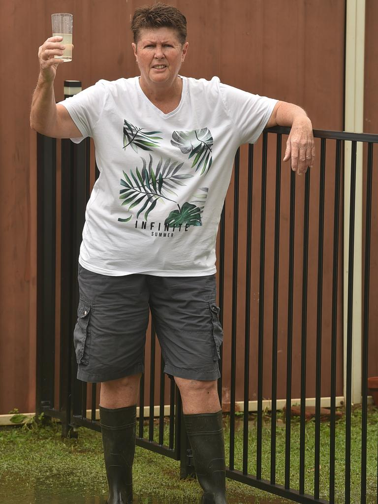 Leanne Dobbin, standing in sewage in her backyard, is one of many Wulguru residents that experiences poonami when the rain comes. Picture: Evan Morgan