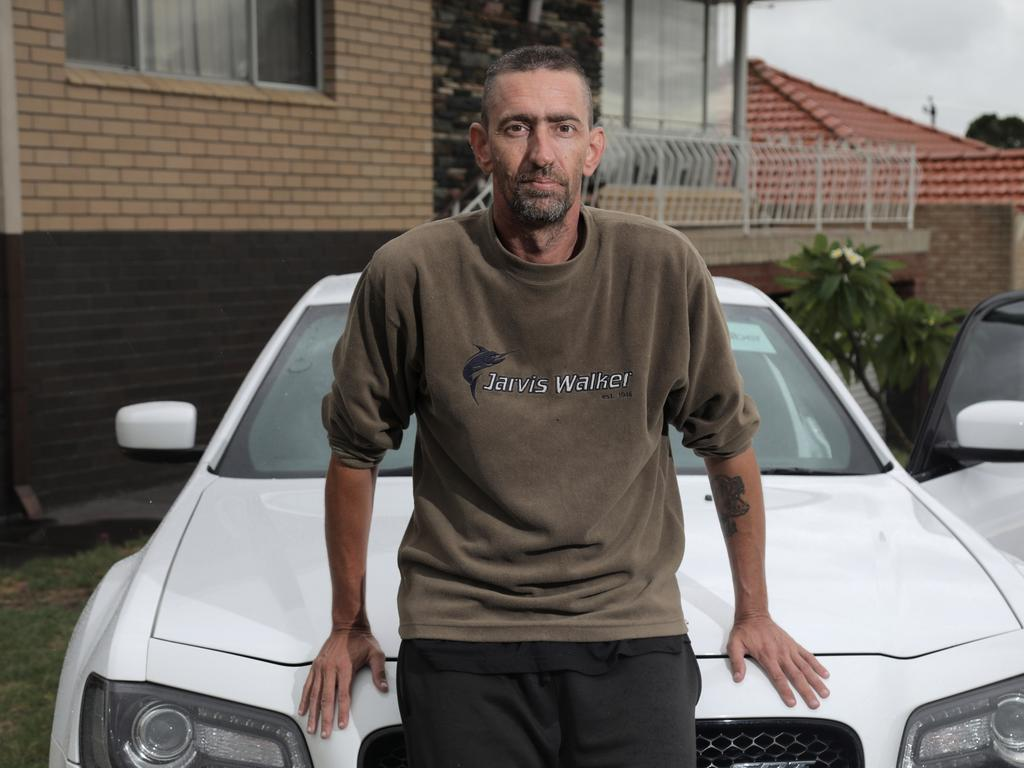 Chris Carlyon used to be homeless and now drives his Chrysler for Uber, making up to $2000 over a weekend pre-COVID. Picture: NCA NewsWire/Philip Gostelow
