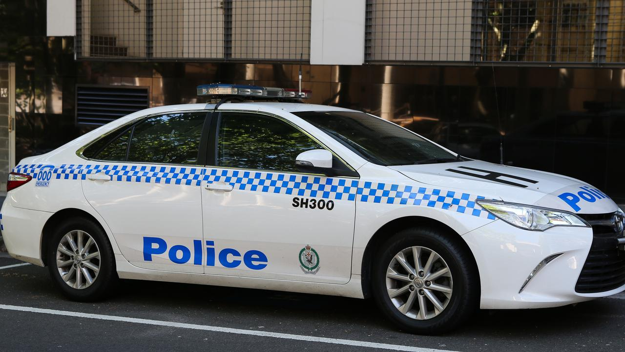 An elderly man and a woman have allegedly been held hostage as police try to track down a person accused over the siege.