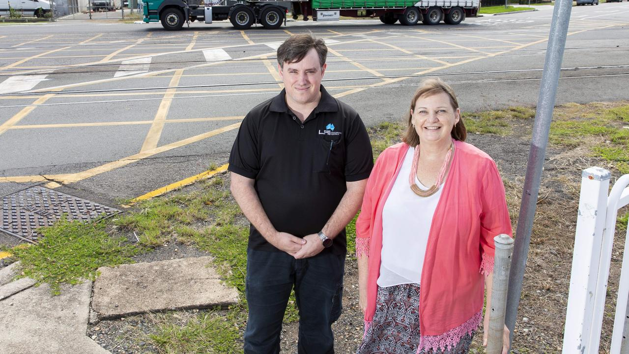 Lytton workers Chris Chandler and Bronwyn Brown have campaigned for a fix for the dangerous Lindum crossing for years. Picture: AAP Image/Richard Walker