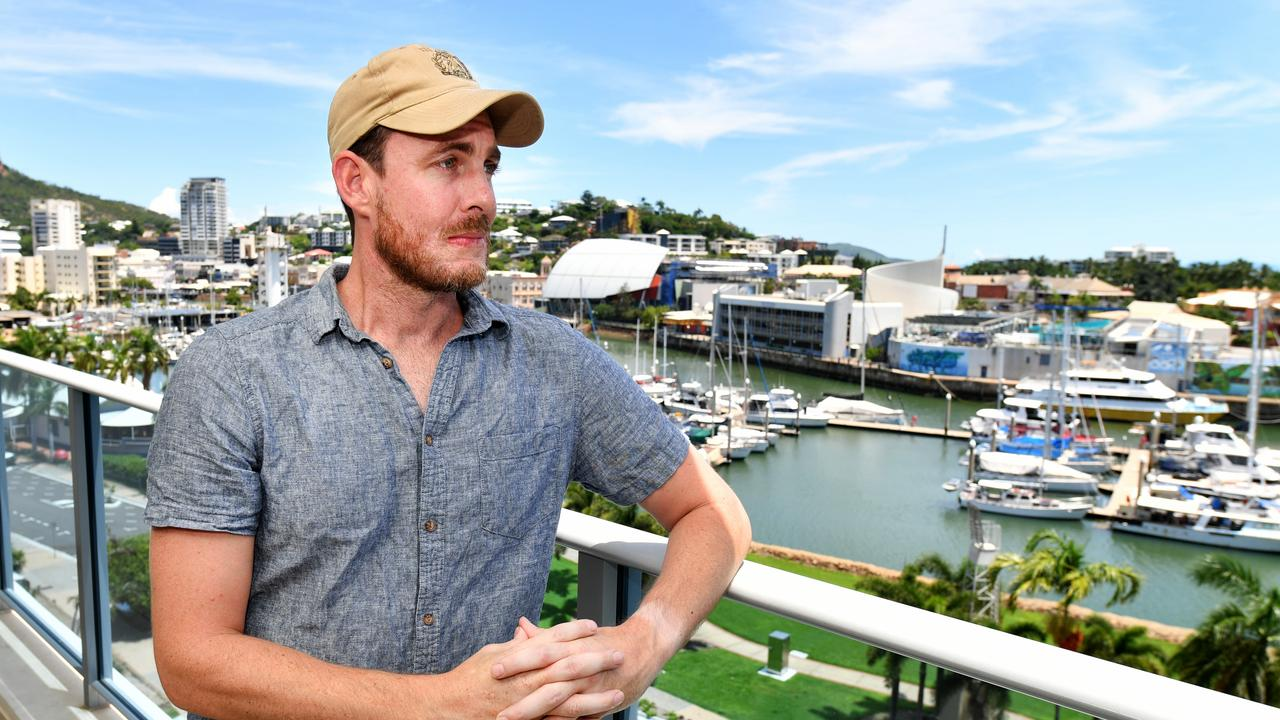Joel Turner pulled a man out the water at the marina in Ross Creek. Joel heard the cries for help from his apartment balcony. Picture: Alix Sweeney