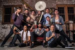 Hot Potato Band's larger-than-life brass collective is a breath of fresh air, setting a new bar for energetic and interactive musical performances.