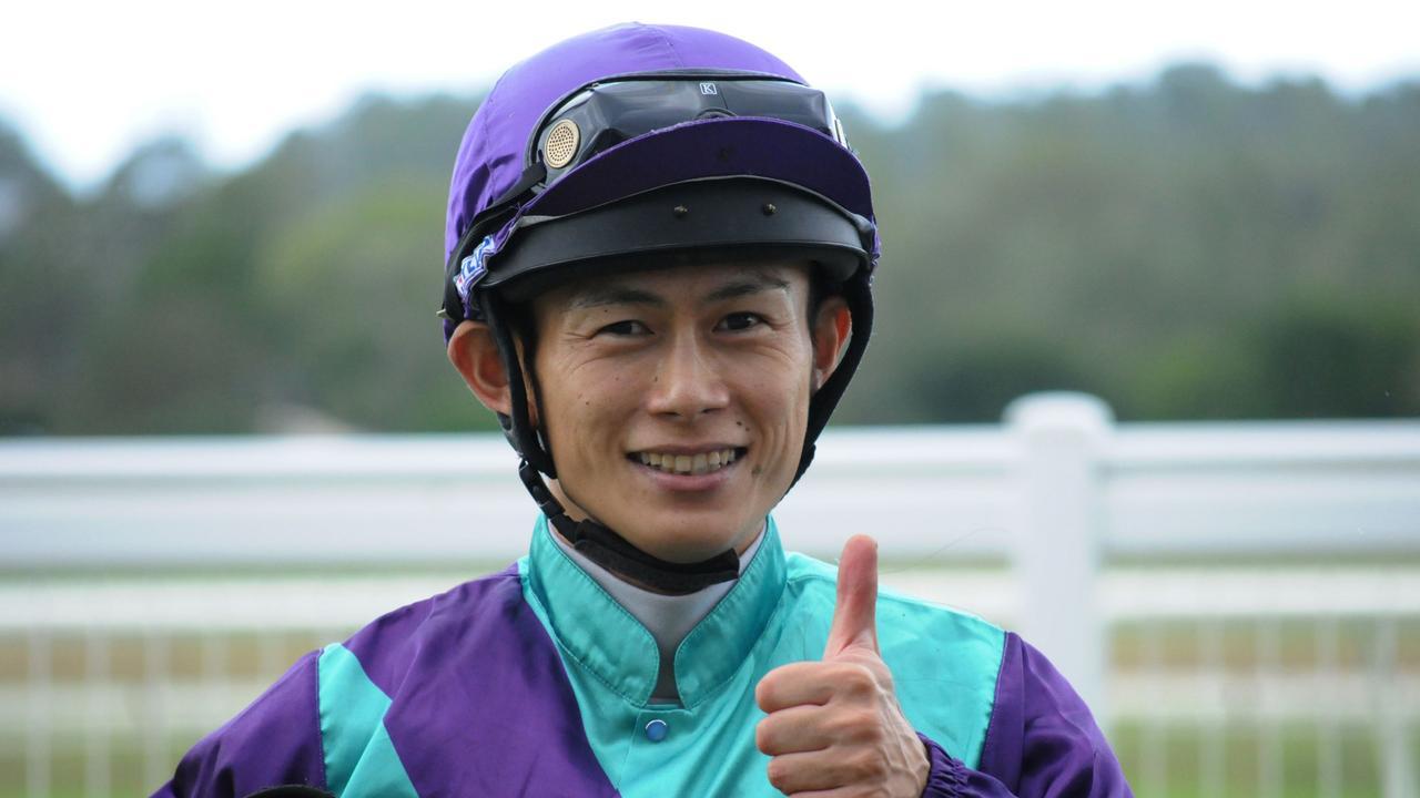 Winning jockey Noriyuki Masuda enjoys his day out at Ipswich racetrack. Picture: Claire Power