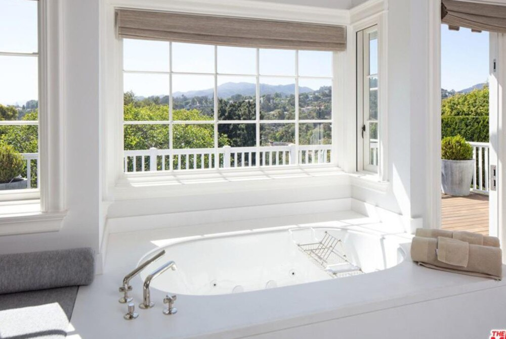 Take a bath with a glorious view in the master bathroom. Picture Realtor