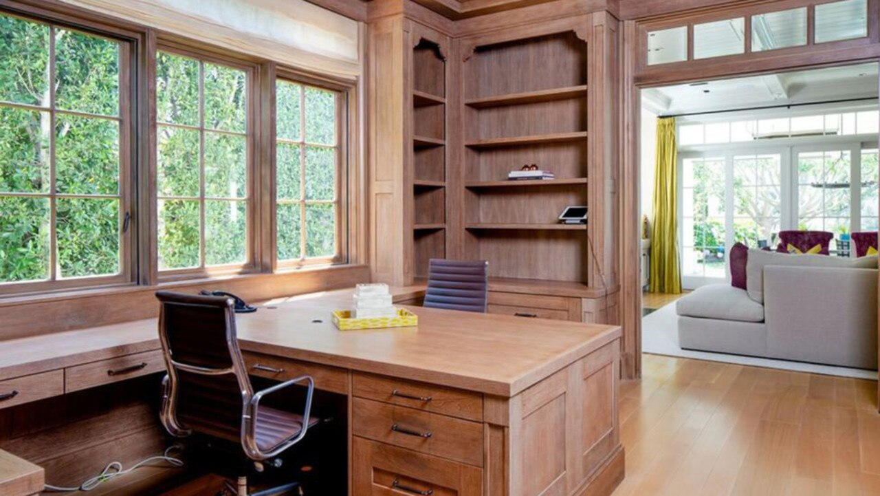 The wood-panelled library with built-in shelves. Picture: Realtor