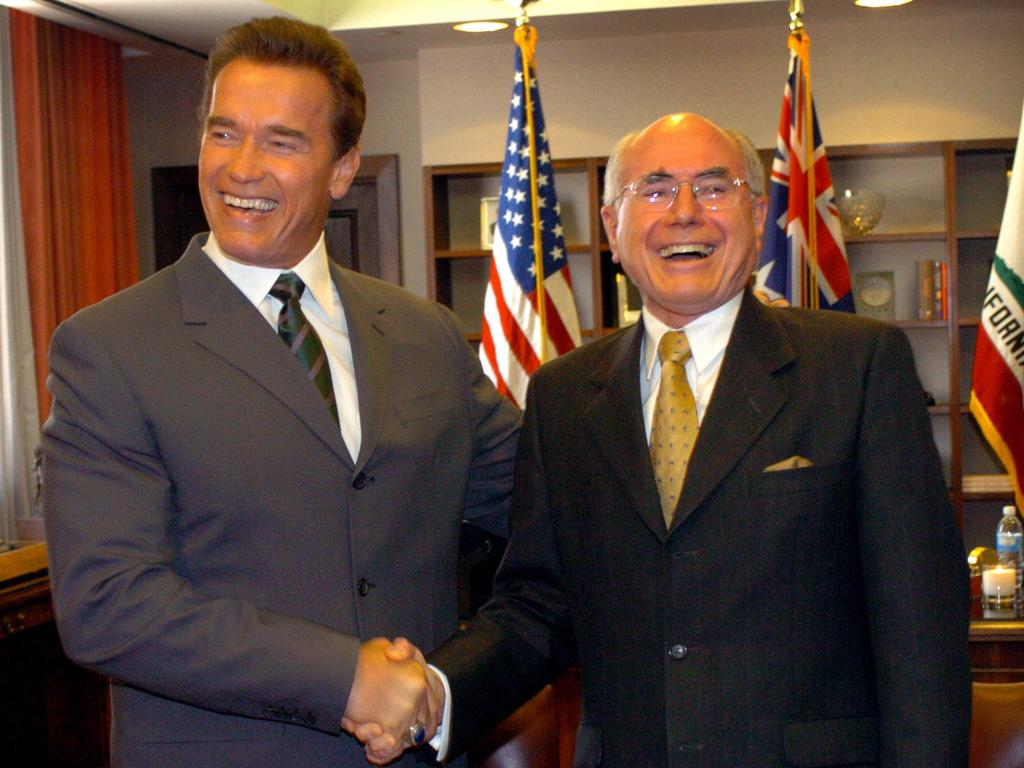 California Governor Arnold Schwarzenegger welcomes John Howard at his office in Los Angeles in 2004. Picture: Ray Strange