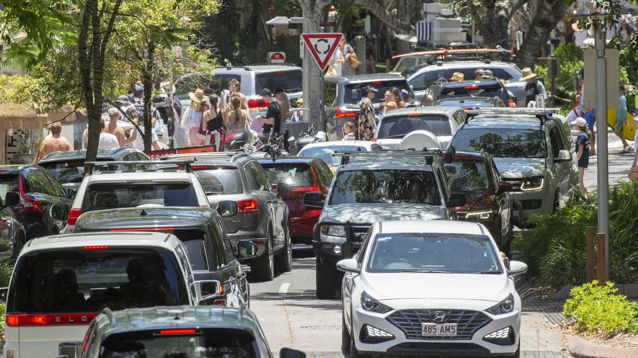 Holiday traffic jam on Hastings street in Noosa as crowds pack in to the popular tourist town. Picture: Lachie Millard