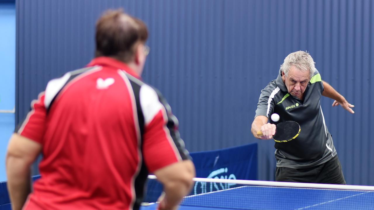 Donna and Kev Abbott battle it out in Mackay table tennis Tuesday morning fixtures. Picture: Charlie Payne