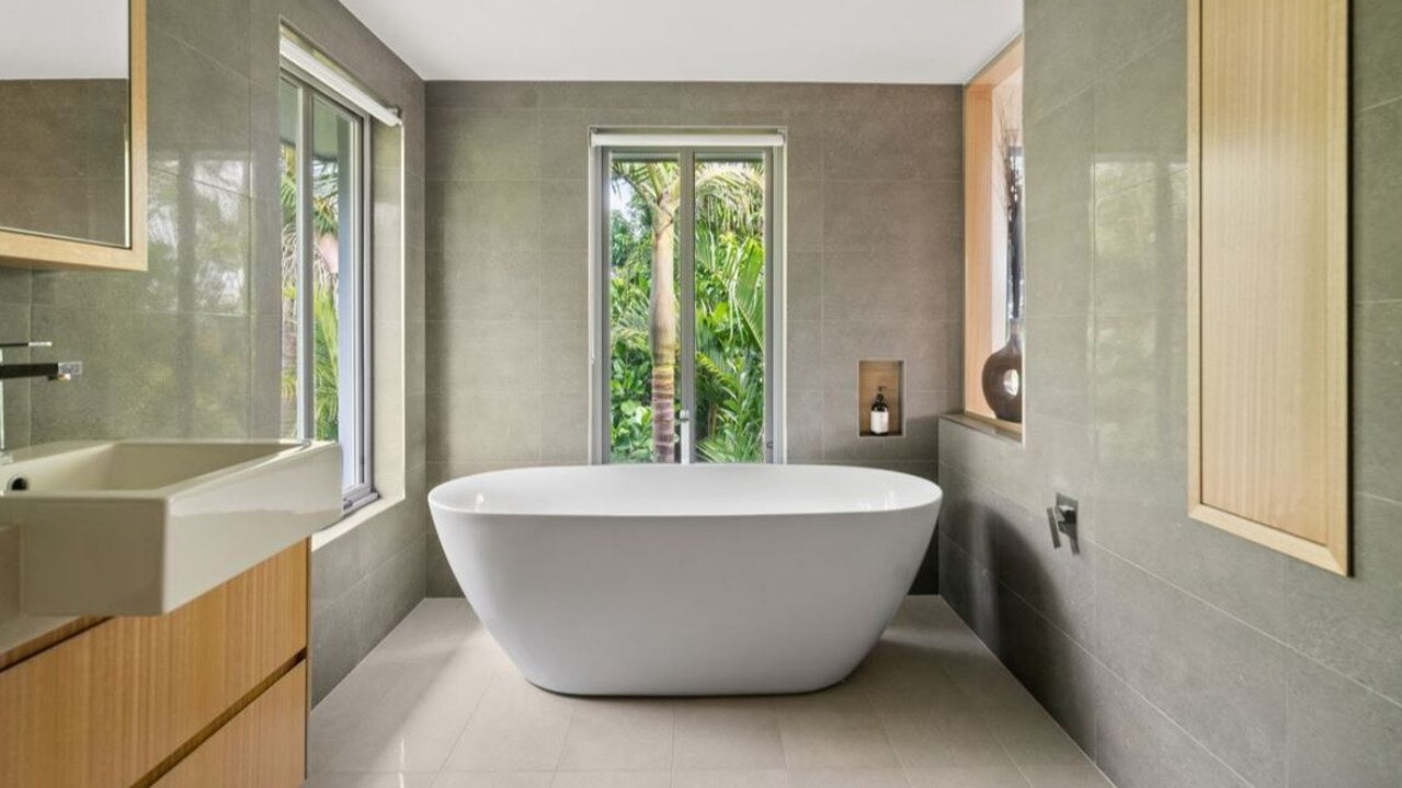 The home has three beautifully designed bathrooms.