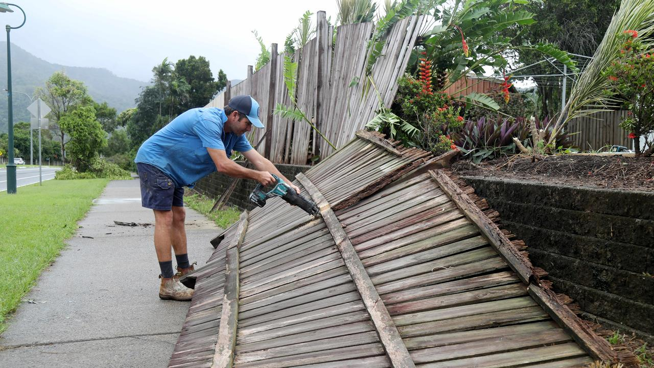 Building contractor Mick Black repairing one of the many fences that blew down along Hambledon Rd in Edmonton. Picture: Stewart McLean