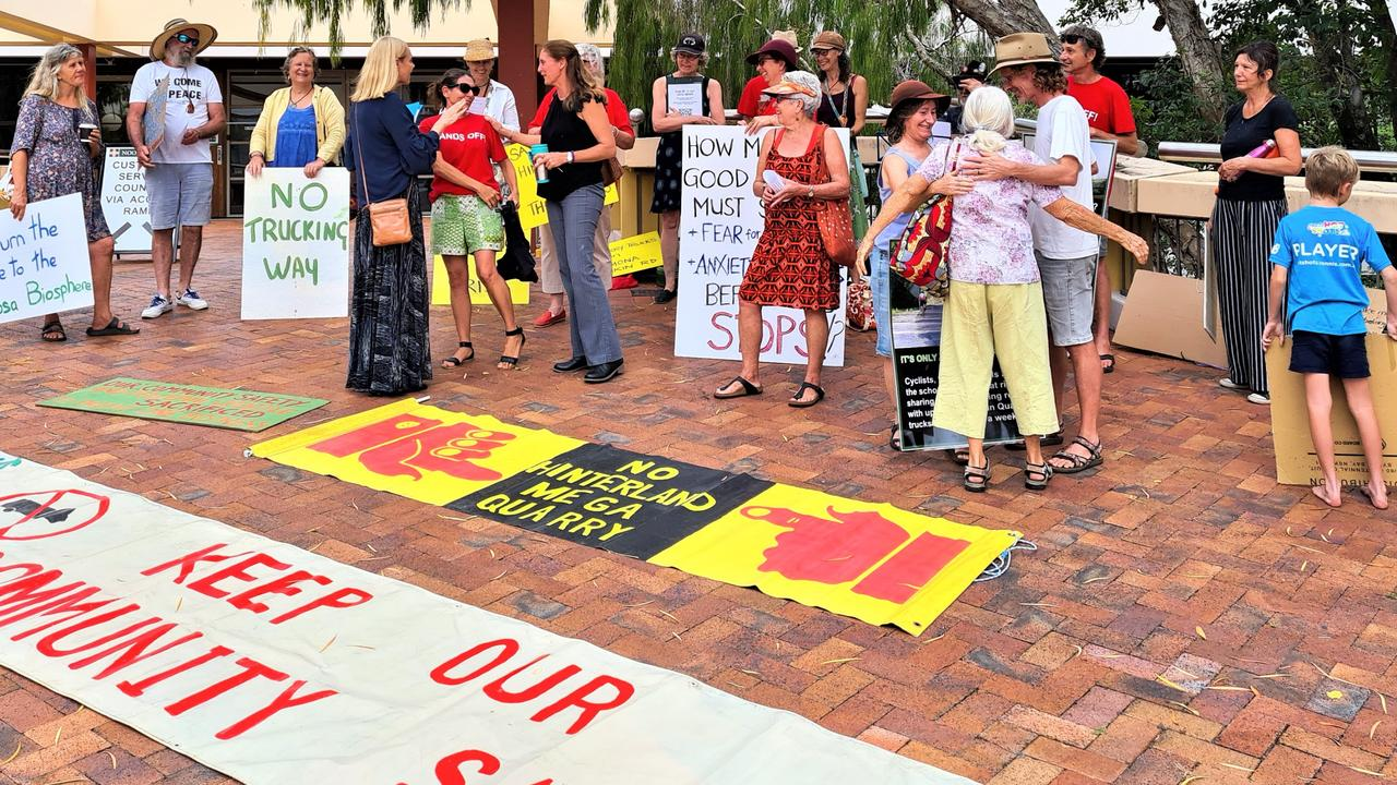 Noosa MP Sandy Bolton speaks with Save Noosa Hinterland protesters outside Noosa Council chambers on Wednesday about the quarry truck use of rural roads.