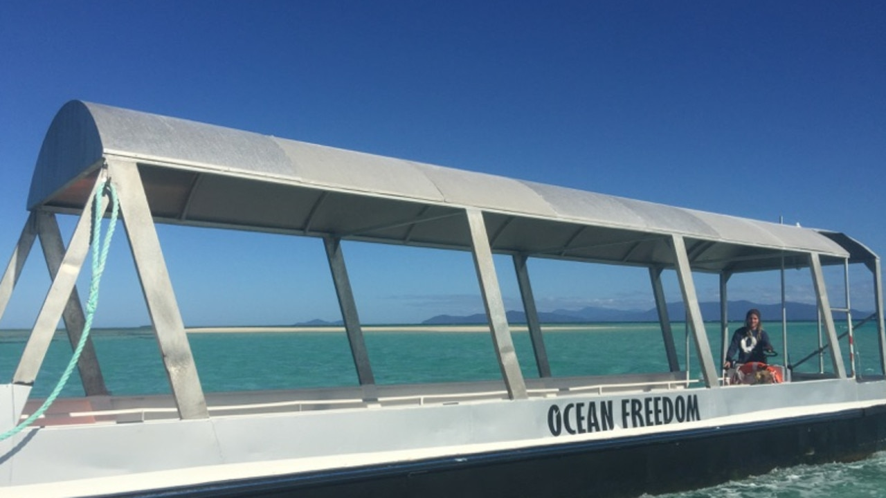 This 11.5m glass bottom boat with Beach Buggy Ocean Freedom written on side was lost during stormy seas on Monday off Cairns.