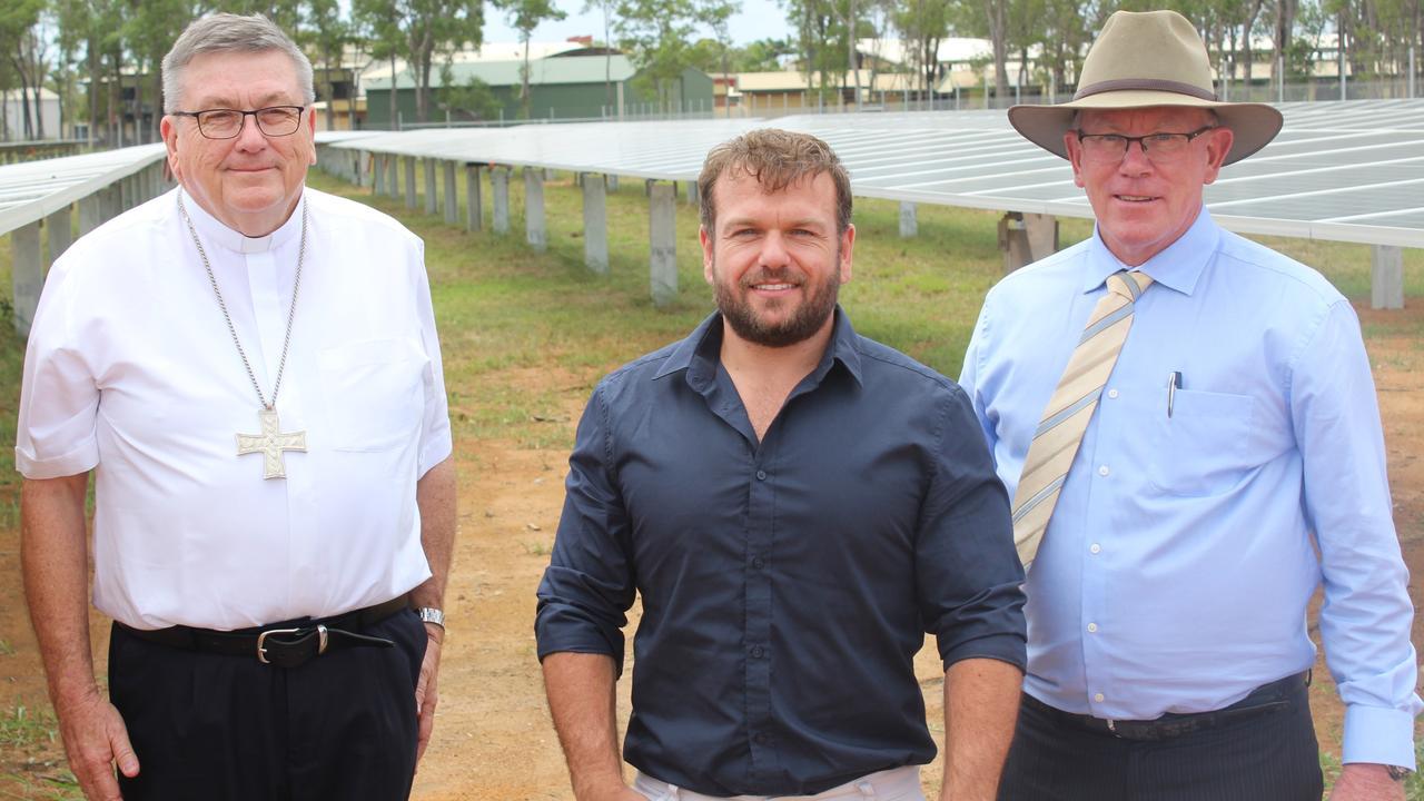Bishop Michael McCarthy, Jack Hooper from GEM Energy and Shalom College principal Dan McMahon at the school's solar farm.