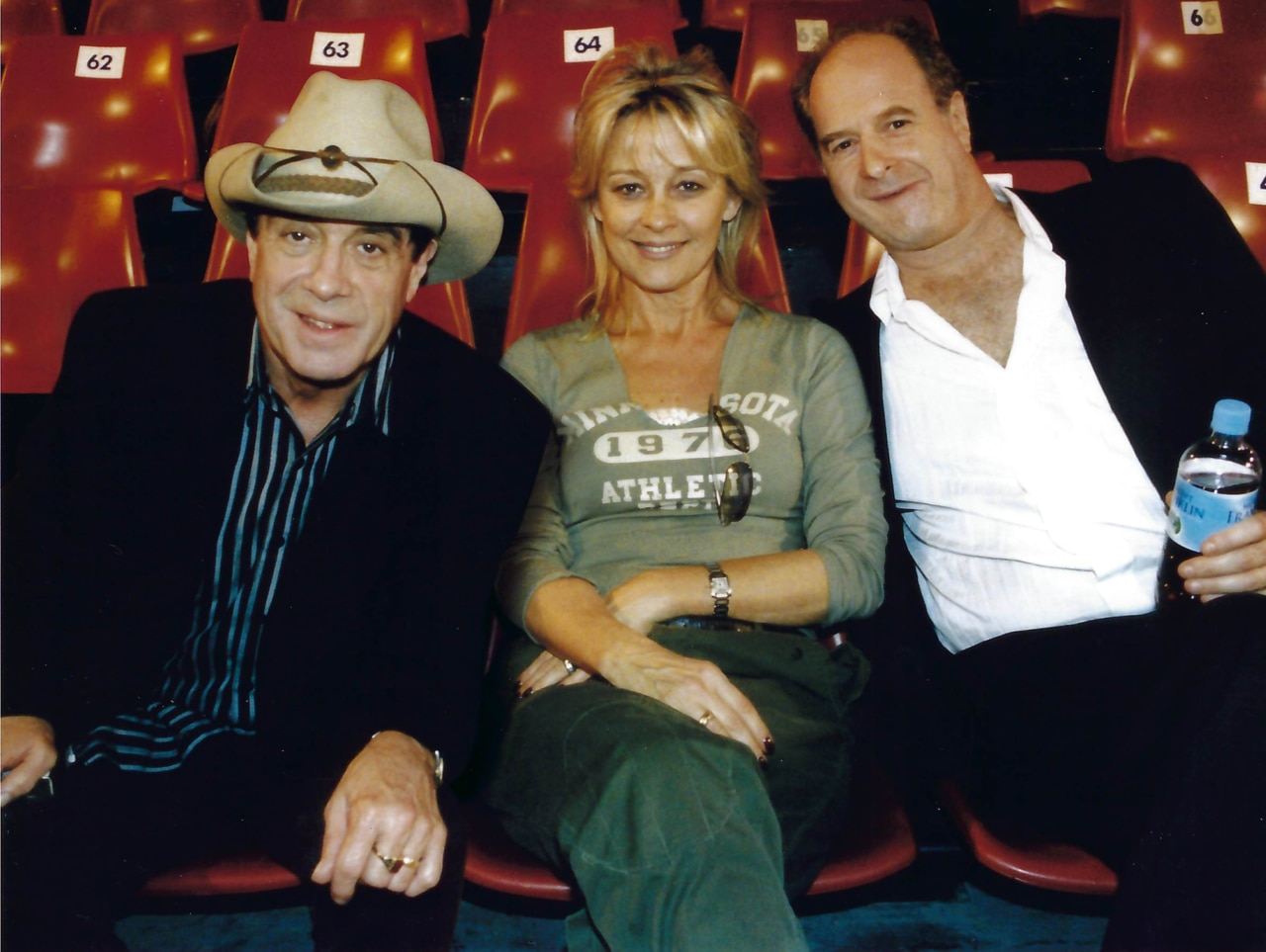 Molly Meldrum (left) with Sue and Michael Gudinski.