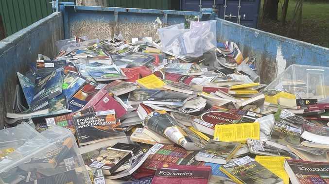 Backflip after high-profile school's mass book dumping