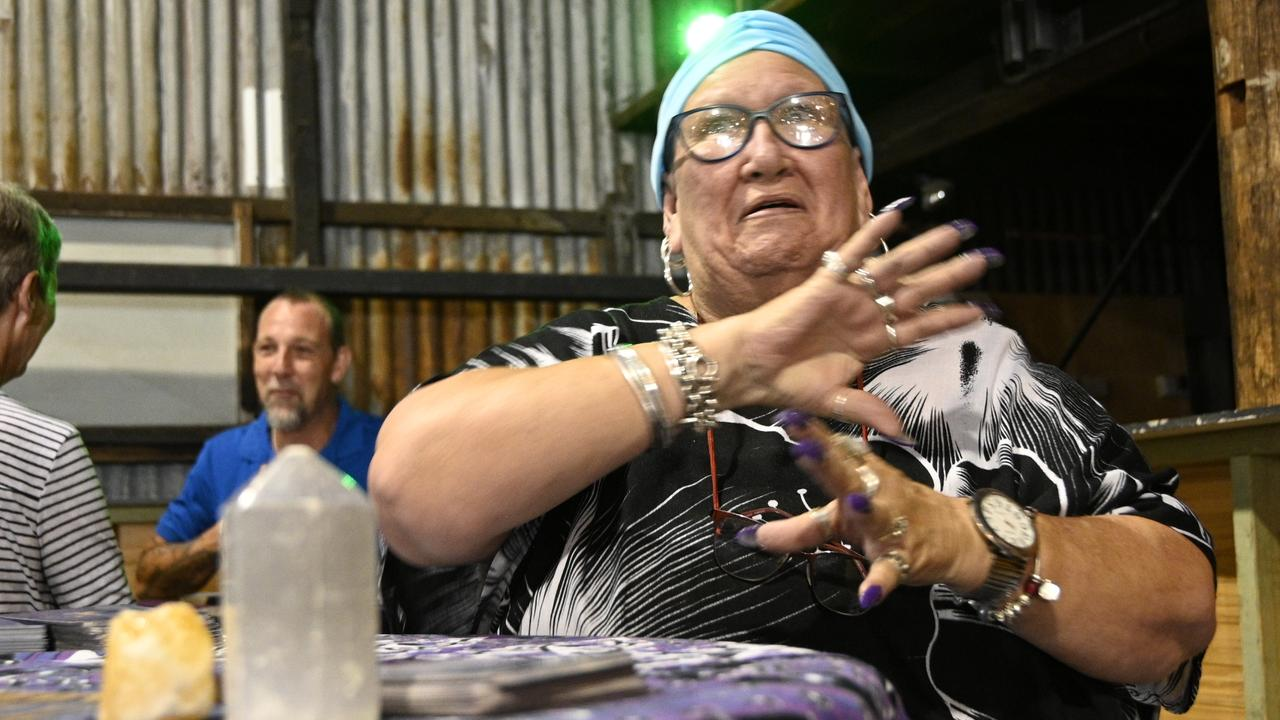 Medium/intuitive psychic Linny provides a spiritual reading for a patron at the Body and Soul Expo at The Mills Precinct.