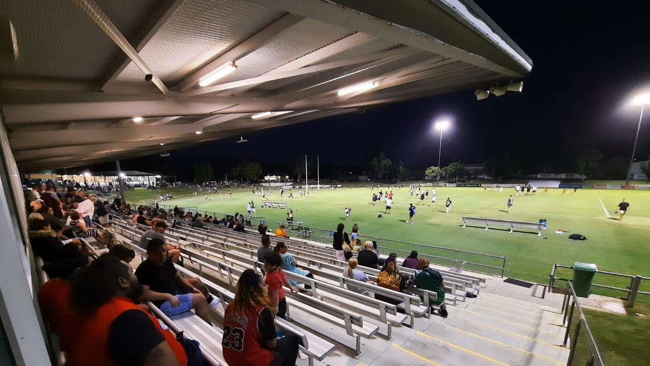 The crowd watches the kids having fun on the field at halftime in the inaugural Ipswich Indigenous v Ipswich All Stars rugby league match at the North Ipswich Reserve. Picture: David Lems